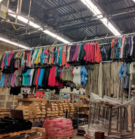 tons of clothes hanging from rack