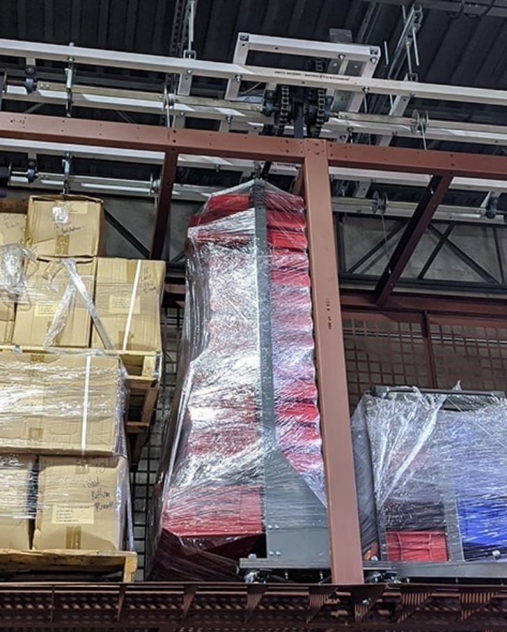 motorized overhead storage lift hung in warehouse