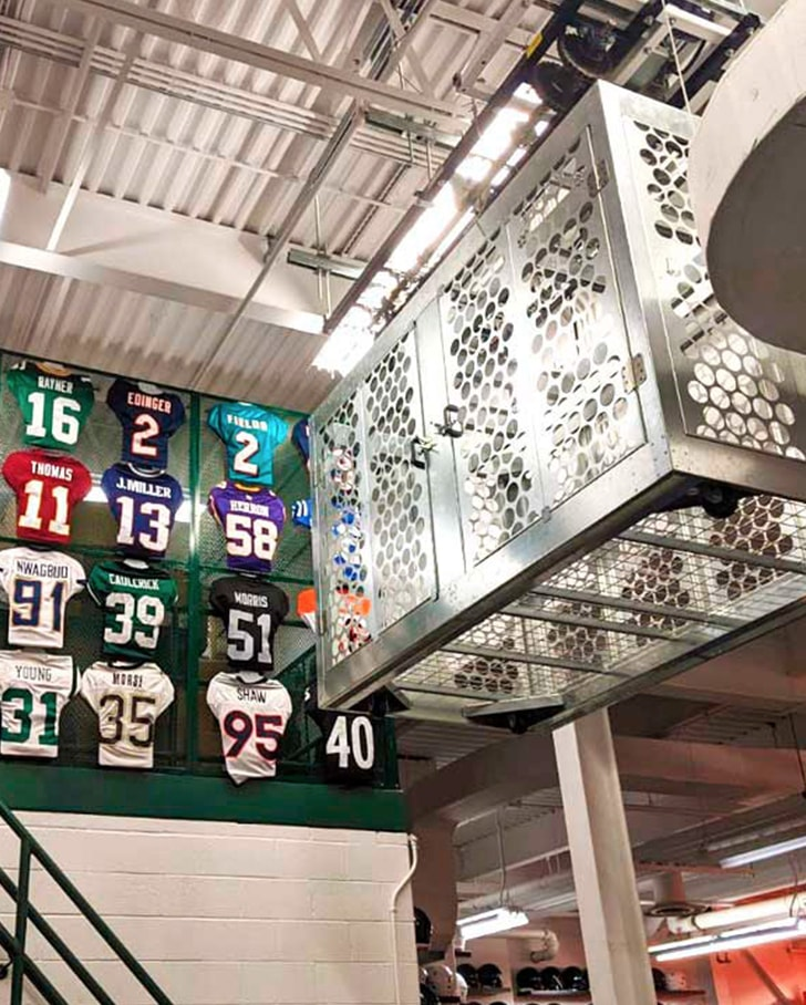 overhead storage equipment in michigan state football facility