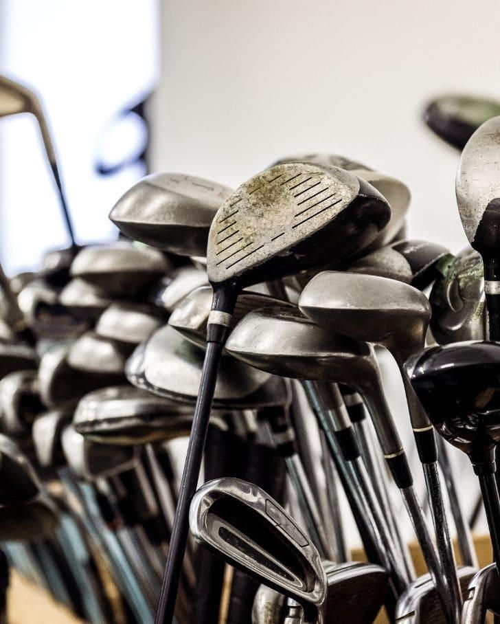 golf clubs sitting in storage